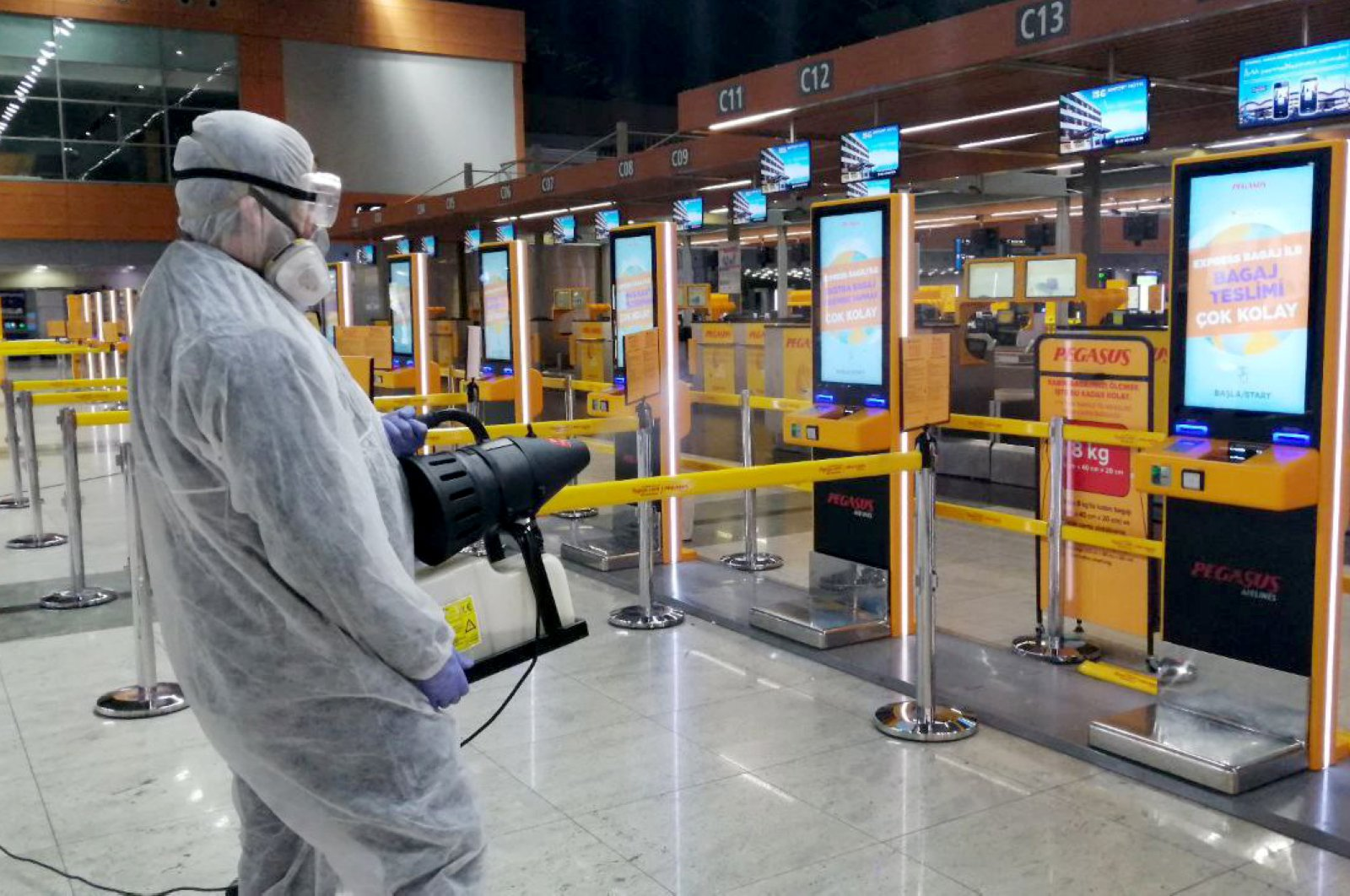 Disinfection works continue in Istanbul's Sabiha Gökçen Airport. (AA Photo)