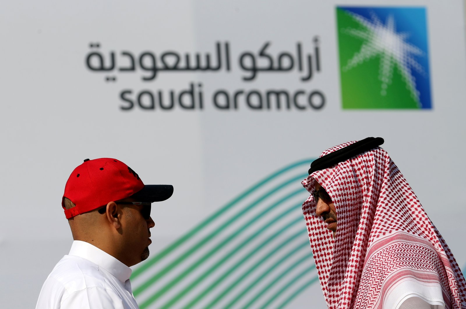 Members of media chat before the start of a press conference by Aramco at the Plaza Conference Center in Dhahran, Saudi Arabia, Nov. 3, 2019. (Reuters Photo)