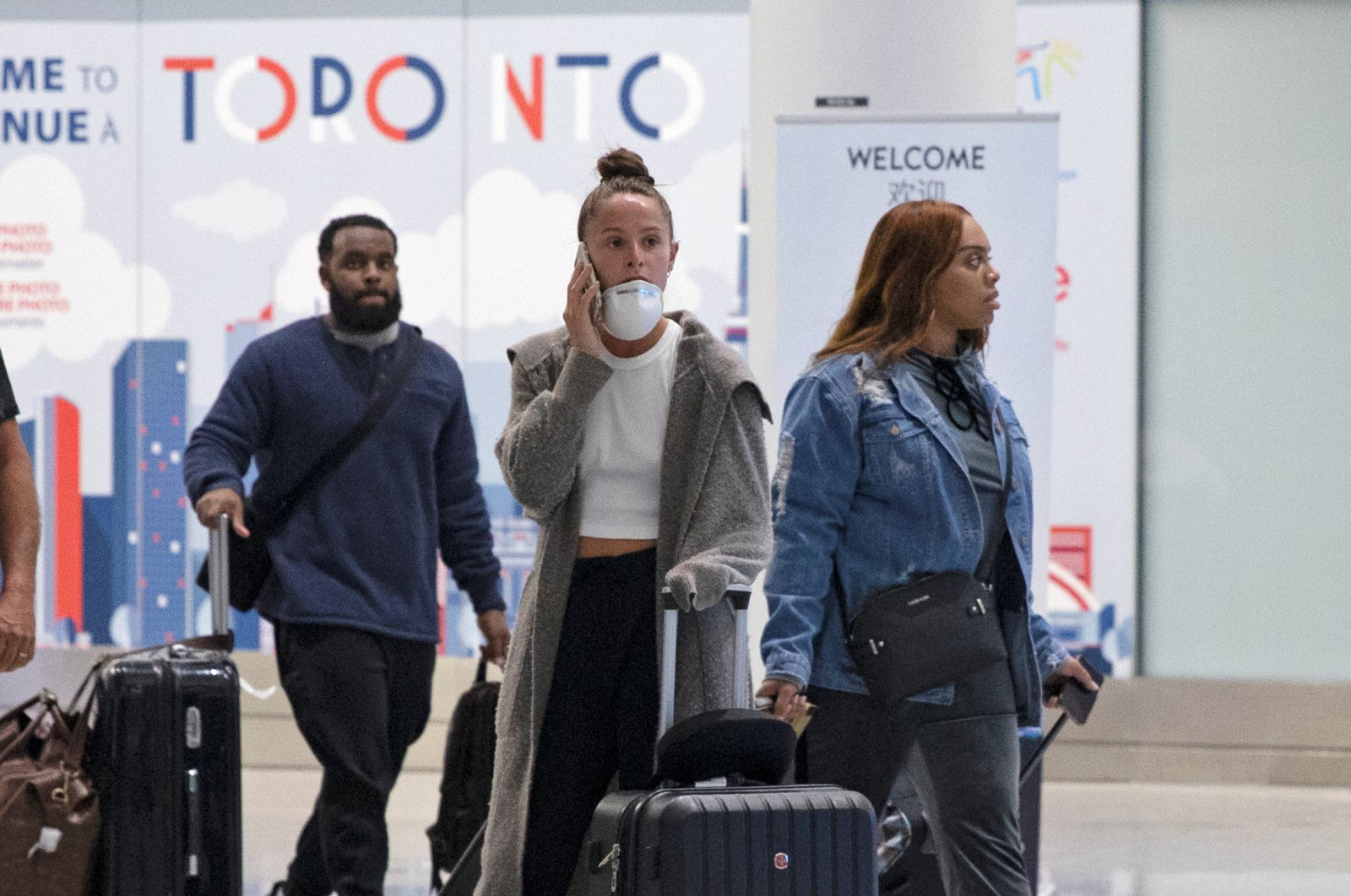 A traveler makes a phone call in the international arrivals lounge, amid a growing global number of coronavirus cases at Pearson Airport in Toronto, Ontario, Canada, March 13, 2020. (Reuters Photo)
