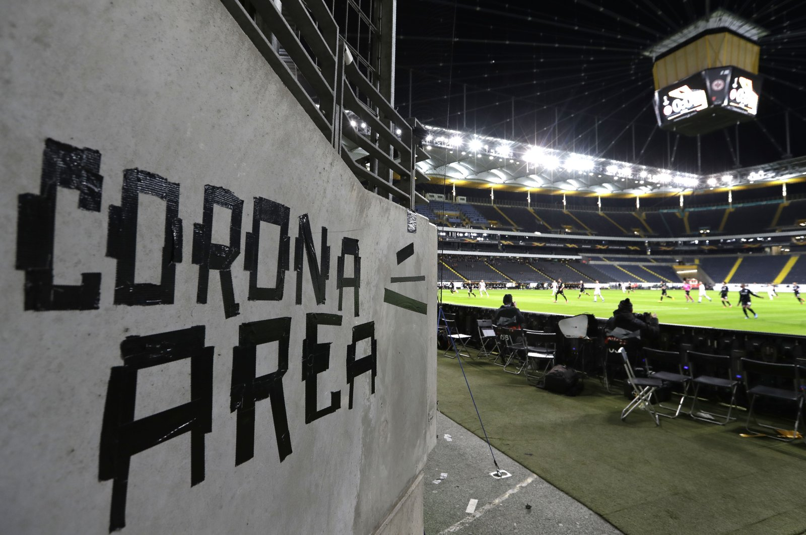 In this Thursday, March 12, 2020 file photo shows a sign taped by Eintracht fans on a wall of the stadium during a Europa League round of 16, 1st leg football match between Eintracht Frankfurt and FC Basel in Frankfurt, Germany. (AP Photo)