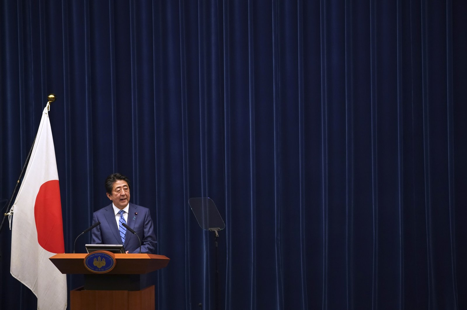 Japanese Prime Minister Shinzo Abe delivers his speech about the coronavirus situation in Japan at the prime minister's office in Tokyo Saturday, March 14, 2020. (AP Photo)
