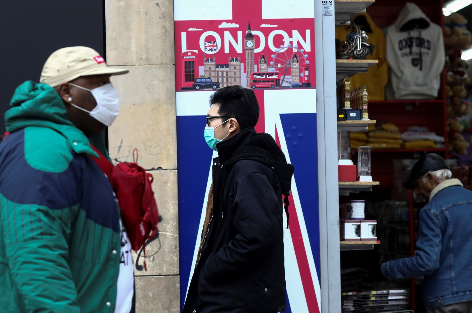People wearing protective masks walk past a souvenir store on Oxford Street in London, Britain March 14. (Reuters Photo)