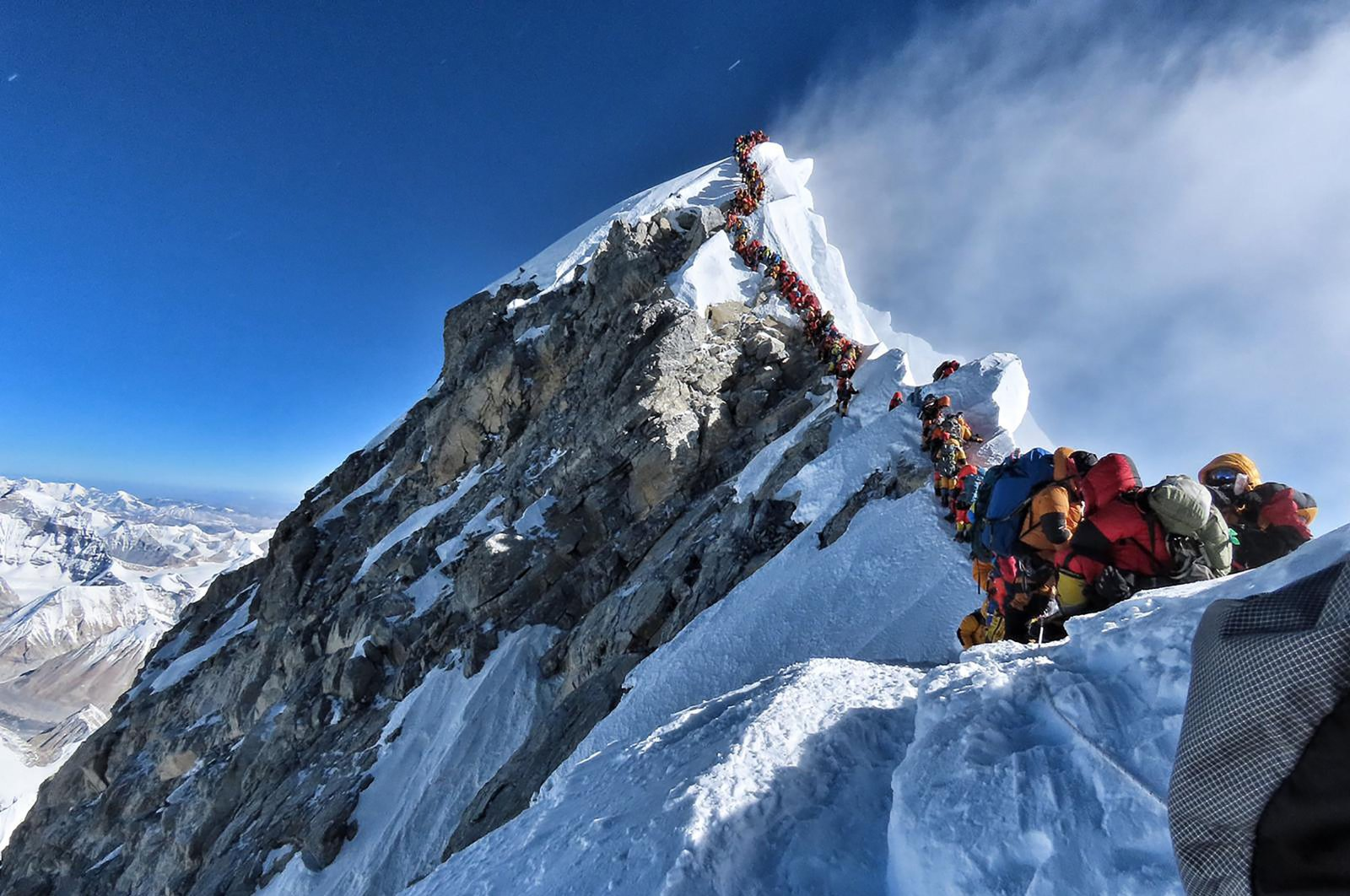 This handout photo taken on May 22, 2019 and released by climber Nirmal Purja's Project Possible expedition shows heavy traffic of mountain climbers lining up to stand at the summit of Mount Everest. (AFP Photo/Project Possible)