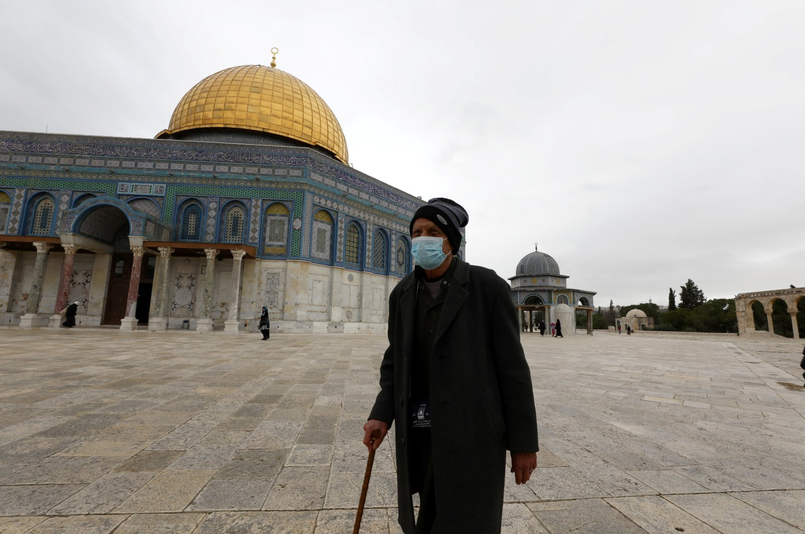 A worshipper walks in the compound known to Muslims as Noble Sanctuary, Jerusalem's Old City, March 13, 2020. (REUTERS Photo)