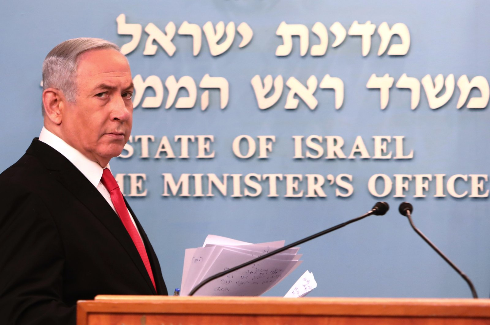 Israeli Prime Minister Benjamin Netanyahu approaches the podium to give a speech from his Jerusalem office, March 14, 2020. (AP Photo)