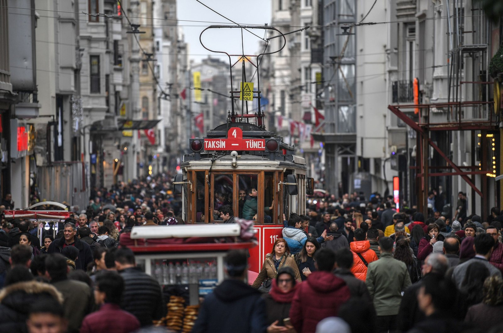 A nostalgic tram drives through a crowd in İstiklal Avenue in Taksim, Istanbul, Jan. 25, 2019. (AFP Photo)