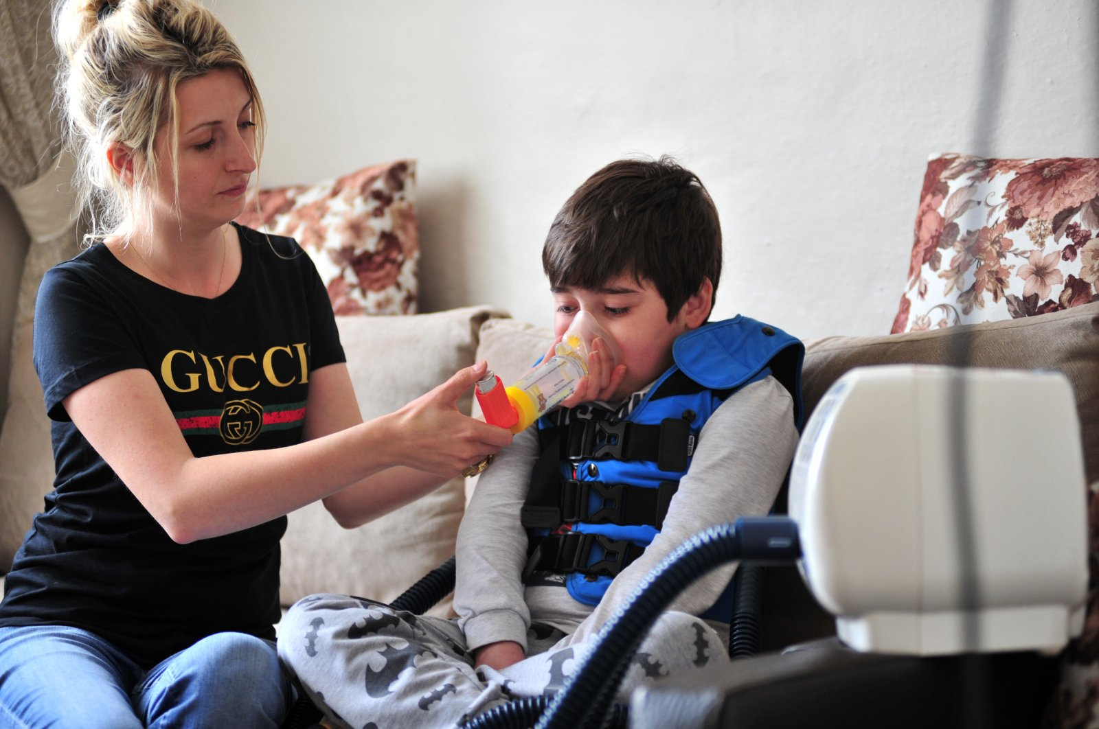 In this undated photo, Kayra Talha Yaman's mother helps him drink. (AA Photo)