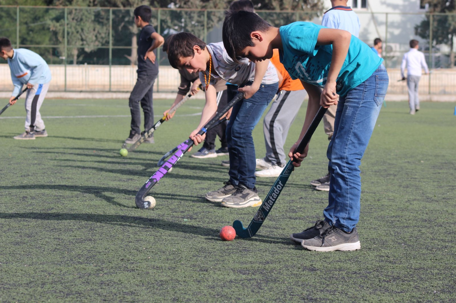 More and more boys take up hockey nowadays in Suruç. (AA Photo)