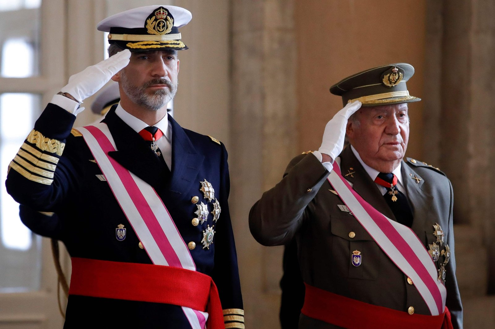 In this file photo taken Jan. 6, 2018, Spain's King Felipe VI (L) and his father King Emeritus Juan Carlos I salute during the Epiphany Day celebrations (Pascua Militar) at the Royal Palace in Madrid. (AFP Photo)