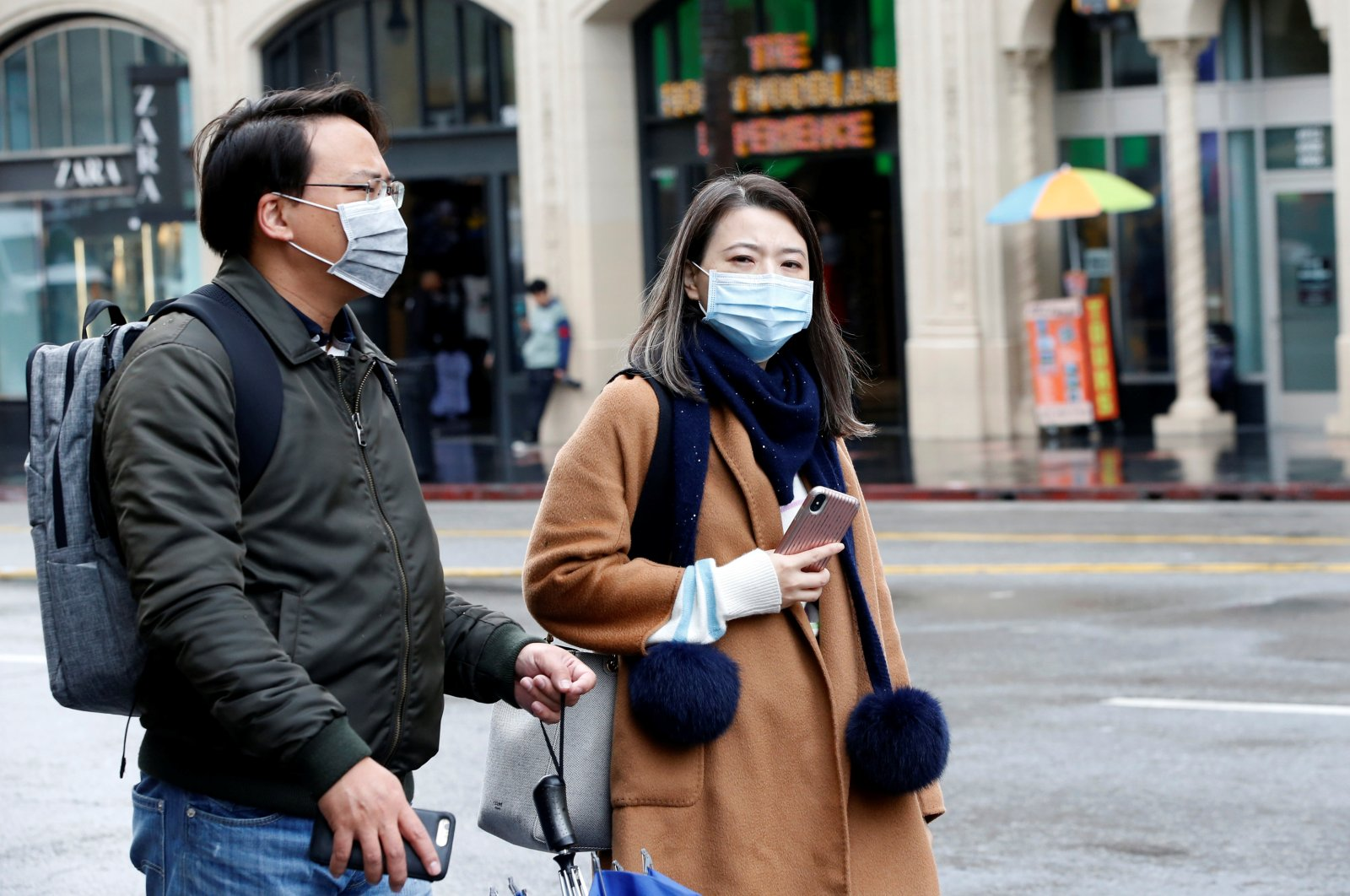 People wearing face masks visit the forecourt of the TCL Chinese Theatre during the global outbreak of coronavirus (COVID-19) in Los Angeles, California, U.S., March 14, 2020. (Reuters Photo)