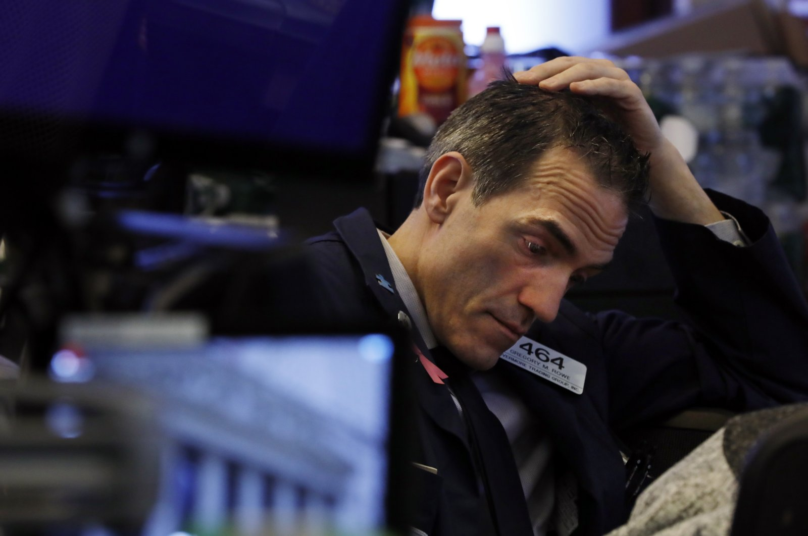 Trader Gregory Rowe prepares for the day's activity on the floor of the New York Stock Exchange, Monday, March 9, 2020. (AP Photo)