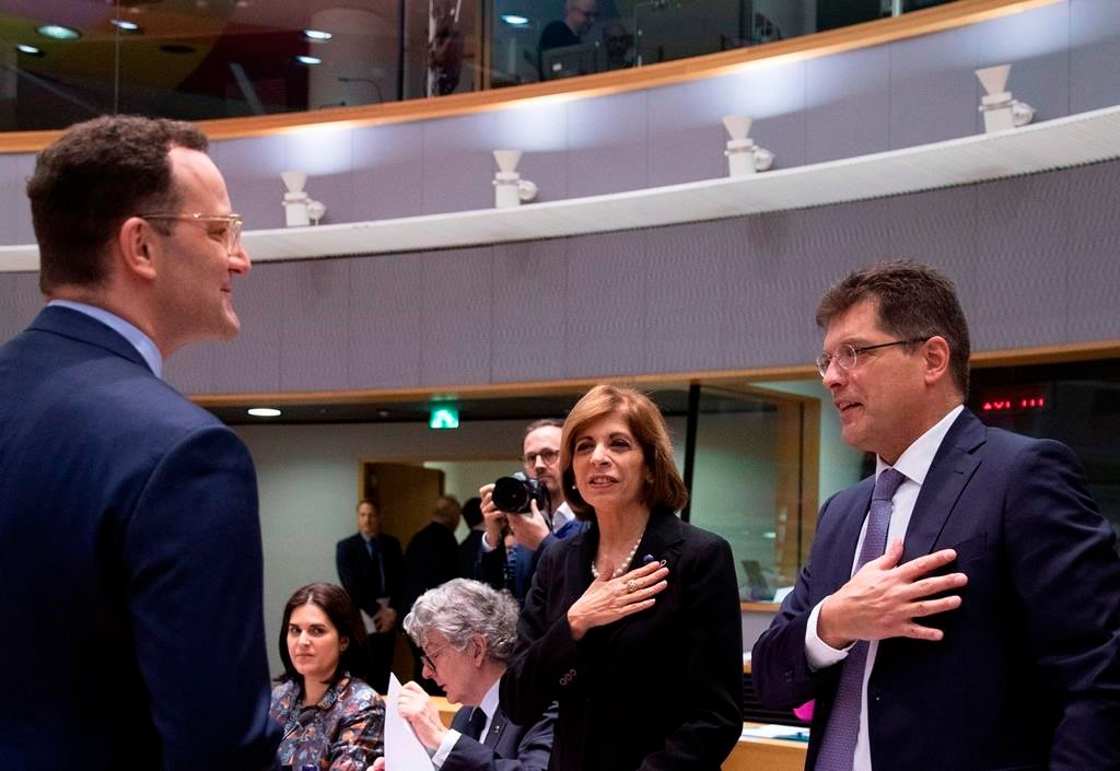 European Commissioner for Health Stella Kyriakides, center, and European Commissioner for Crisis Management Janez Lenarcic, right, put their hands over their hearts in a gesture of hello to German Health Minister Jens Spahn during an extraordinary meeting of EU health ministers in Brussels to discuss the virus outbreak, Friday, March 6, 2020 (AP Photo)