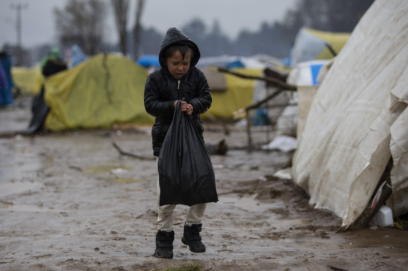 Refugees continue to wait to be taken in by Europe at the Turkish-Greek border on their 18th day despite harsh weather conditions, March 15, 2020. (AA Photo)