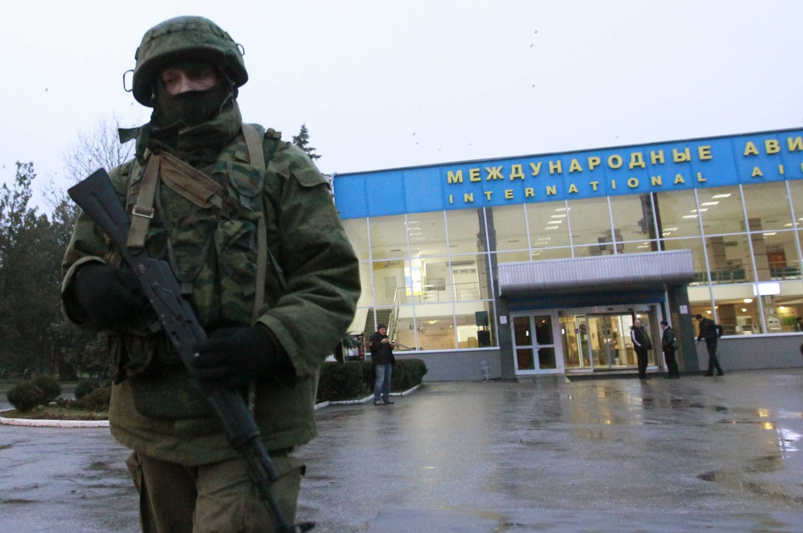 A Russian patrol stands at the international airport in Crimea.