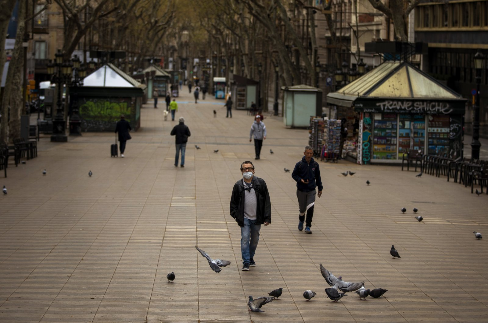 People walk along La Ramblas in Barcelona, Spain, March 15, 2020. (AP Photo)