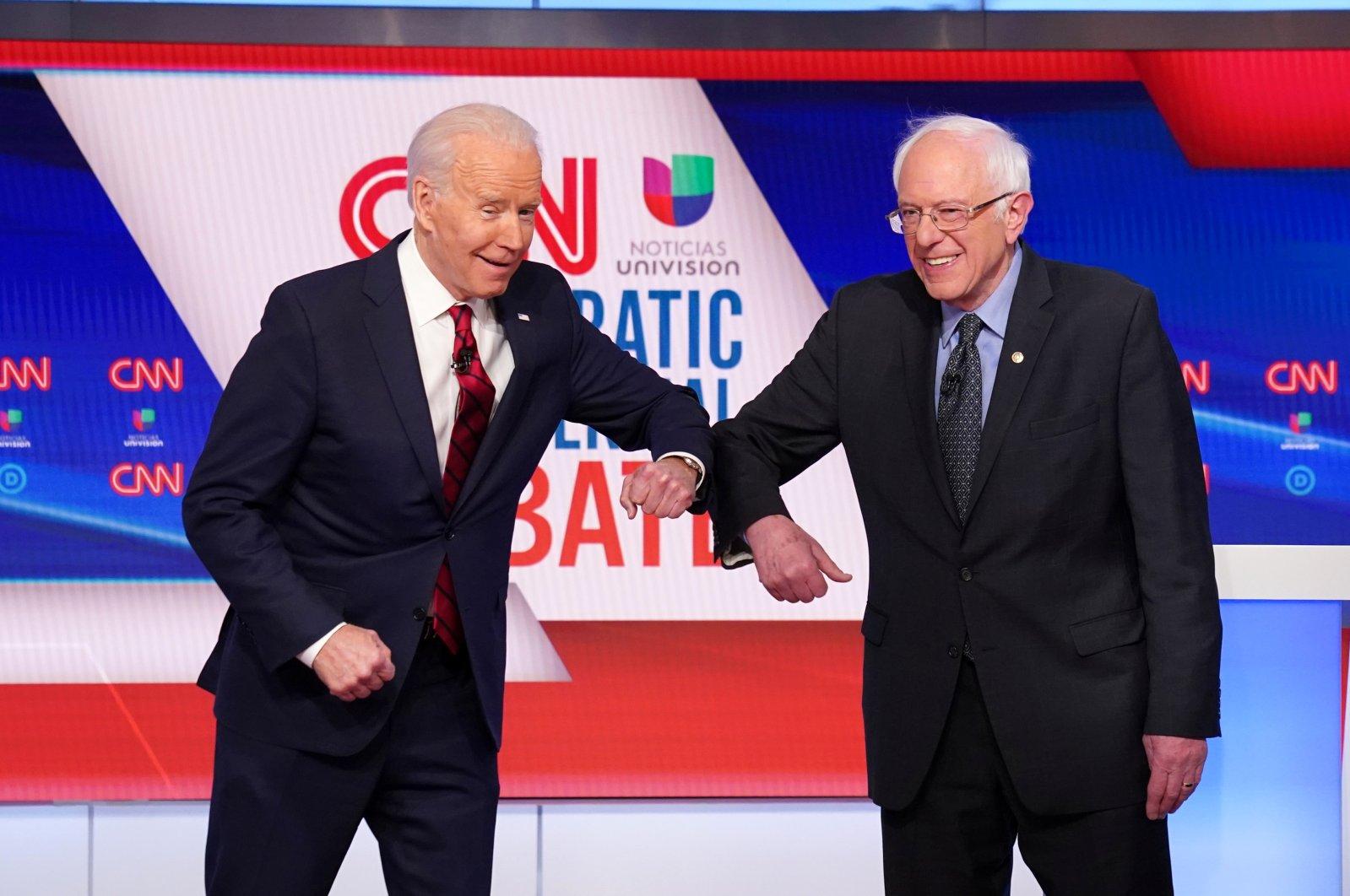 Democratic U.S. presidential candidates former Vice President Joe Biden and Senator Bernie Sanders do an elbow bump in place of a handshake, Washington, March 15, 2020. (REUTERS / Photo)