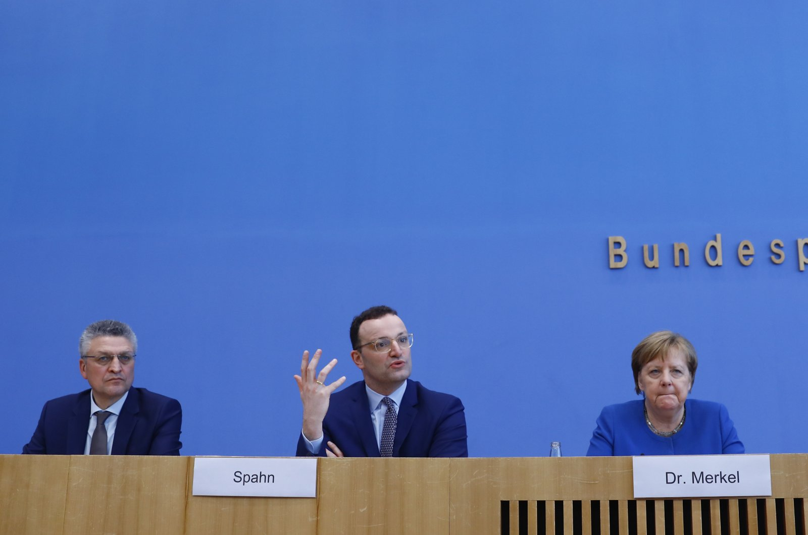 German Chancellor Angela Merkel (R) and Health Minister Jens Spahn (M) and Robert Koch Institute chief Lothar Wieler (L) at a news conference on coronavirus in Berlin, Germany, March 11, 2020. (AA Photo)