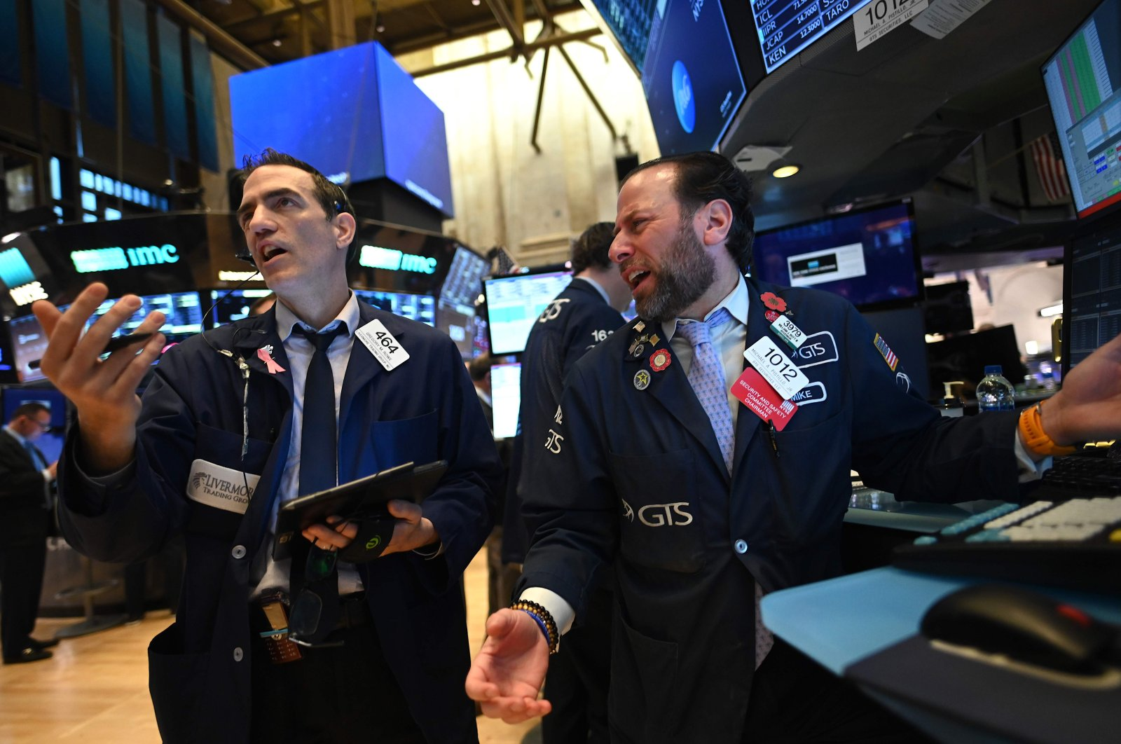 Traders work during the opening bell at the New York Stock Exchange, New York City, U.S., Monday, March 16, 2020. (AFP Photo)