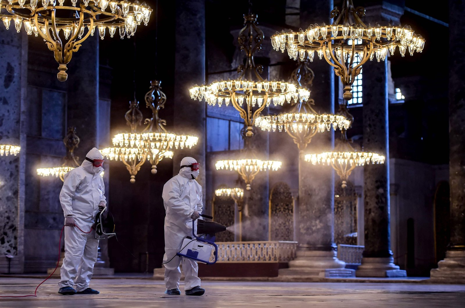 Employees of the Fatih Municipality wearing protective suits disinfect the Hagia Sophia to prevent the spread of the COVID-19, Istanbul, March 13, 2020. (AFP Photo)