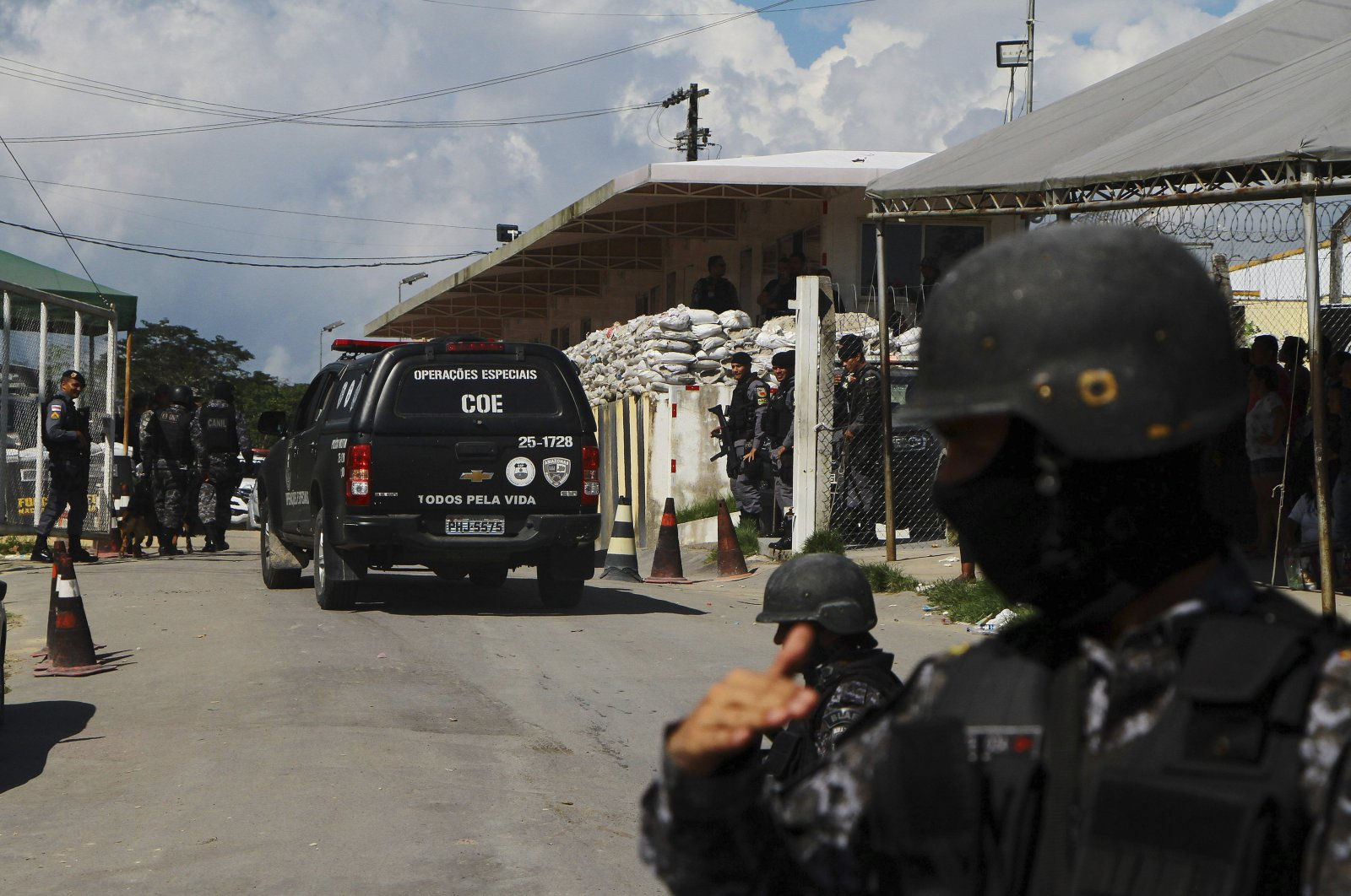 Police guard the entrance to the Anisio Jobim Prison Complex in Manaus in the northern state of Amazonas, Brazil, Sunday, May 26, 2019. (AP Photo)