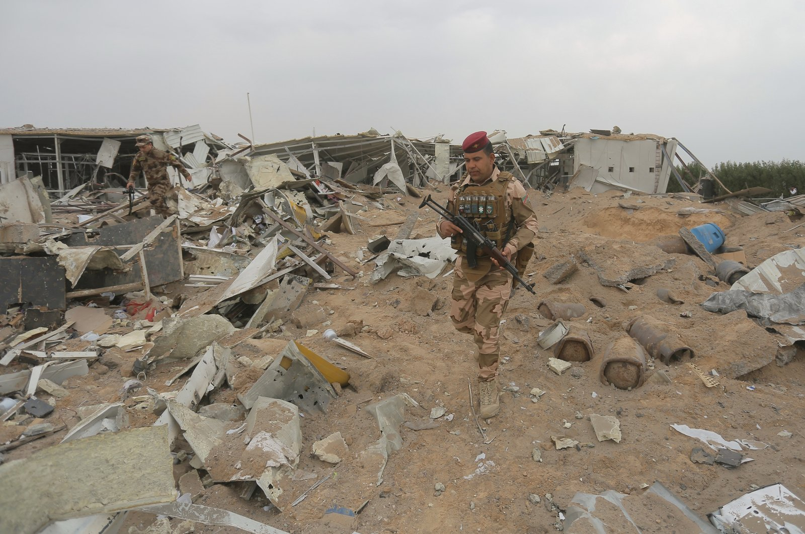 Iraqi army soldiers inspect the destruction at an airport complex under construction in Karbala, Friday, March 13, 2020. (AP Photo)