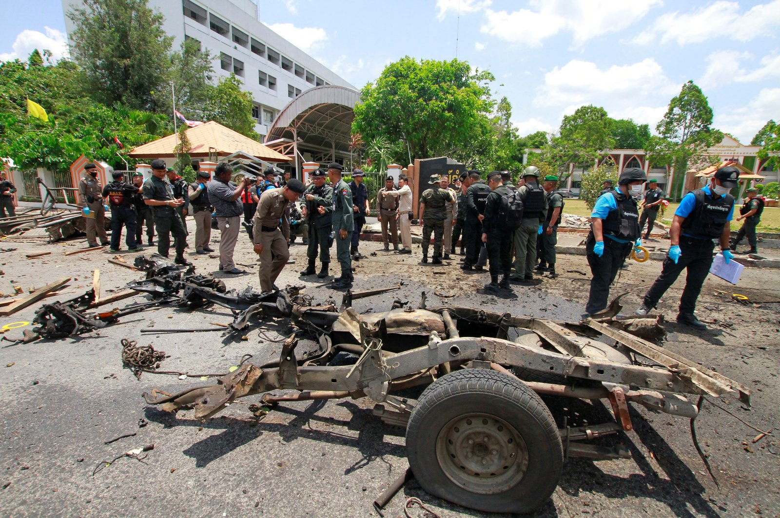 Security personnel inspect the site of a car bomb after it exploded in front of the government's Southern Border Provinces Administrative Centre in Yala, Thailand, March 17, 2020. (Reuters Photo)
