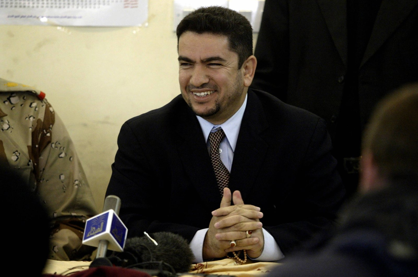 Iraq's new prime minister-designate, Adnan al-Zurfi, speaks to the press at the Human Rights Center, Baghdad, Jan. 25, 2005. (AFP Photo)
