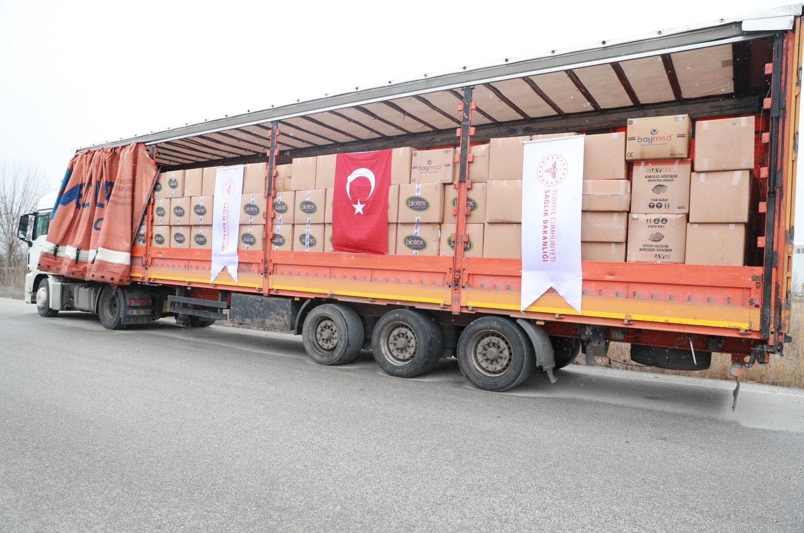 A truck carrying medical aid to Iran parked on a road, Tuesday, March 17, 2020, in Ankara. (İHA Photo)