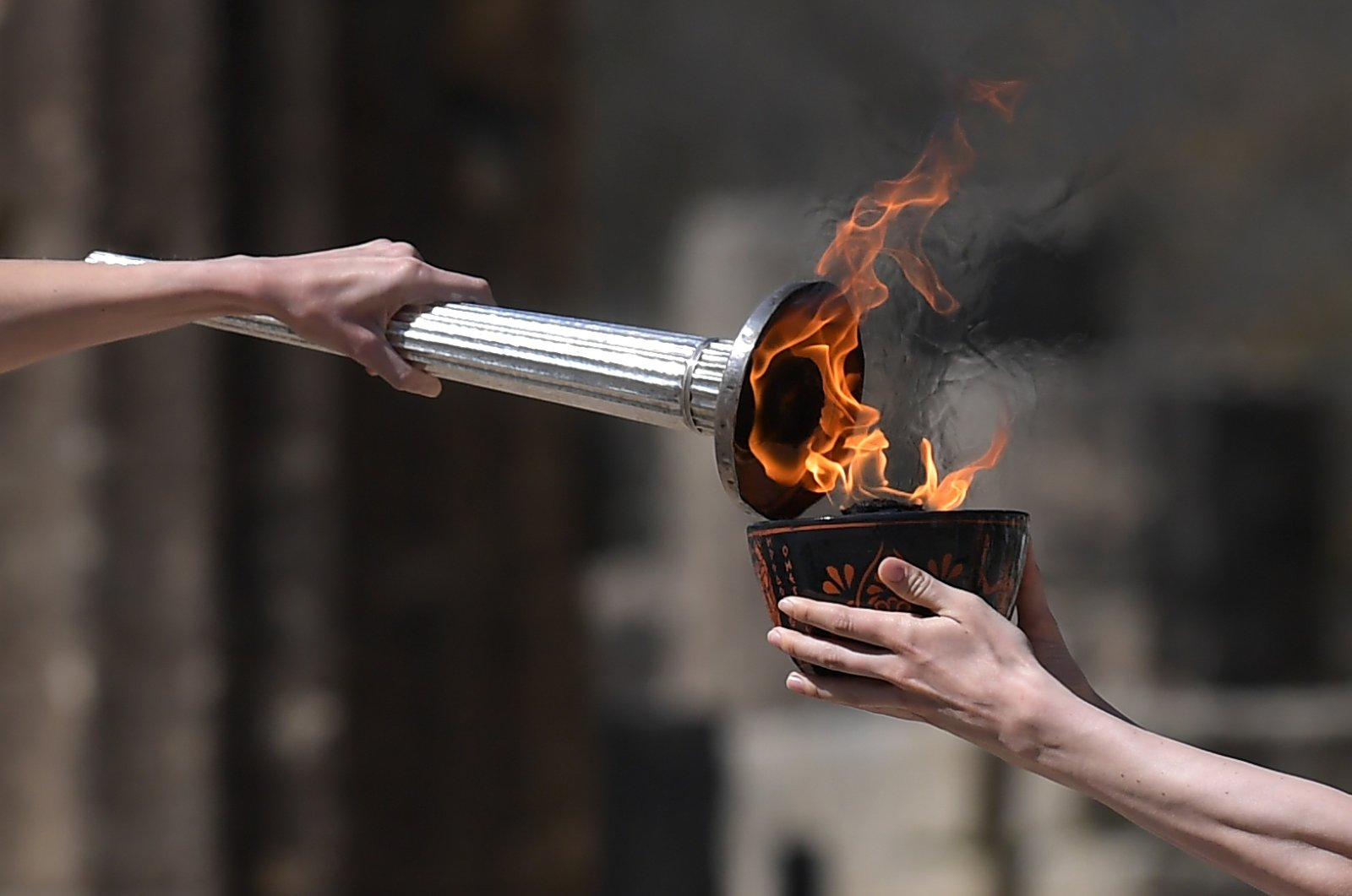Particpants take part in the Olympic flame lighting ceremony in ancient Olympia, ahead of Tokyo 2020 Olympic Games, March 12, 2020. (AFP Photo)