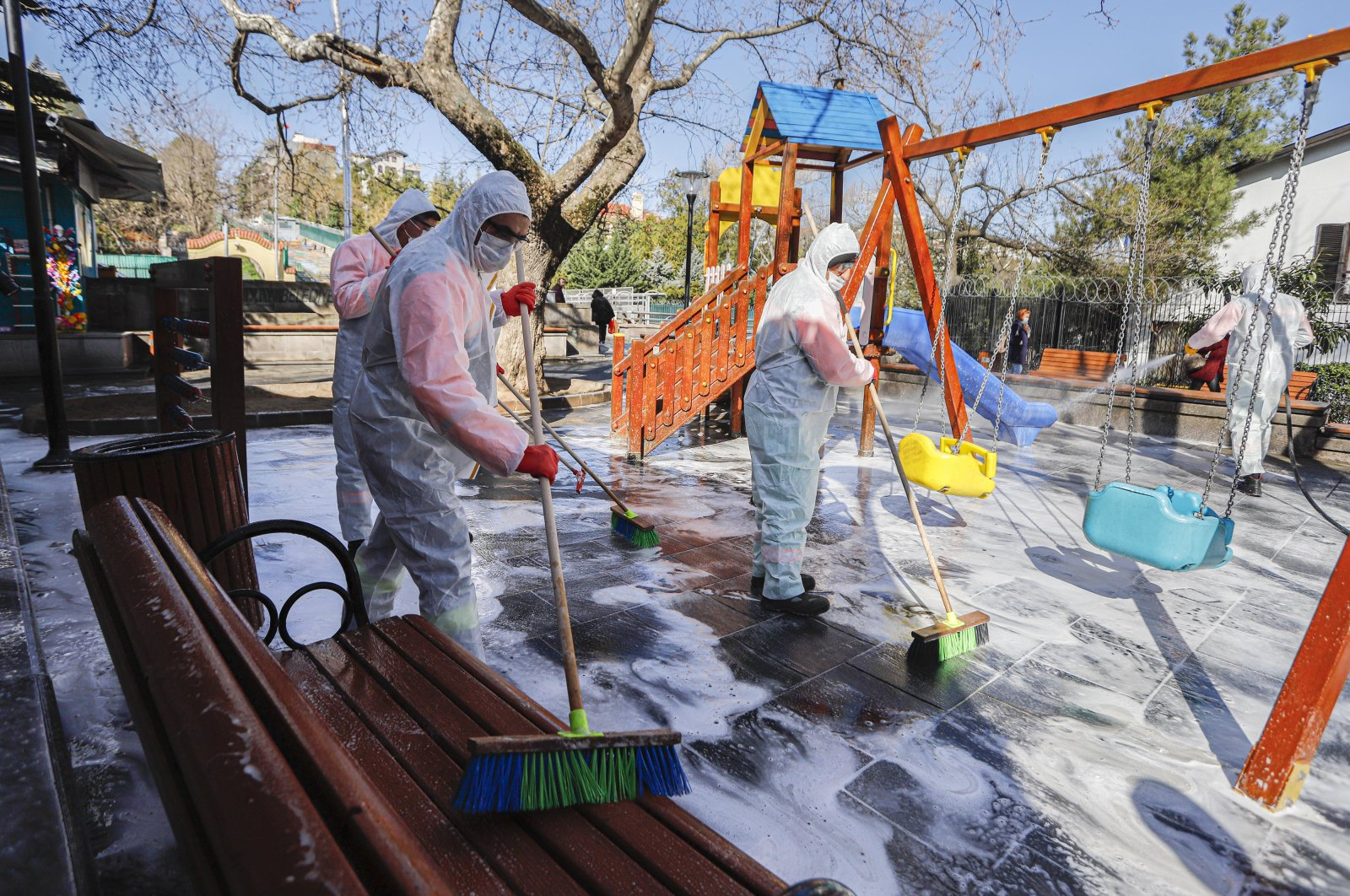 Workers disinfect and clean a playground, Tuesday, March 17, 2020, in Ankara. (DHA Photo)