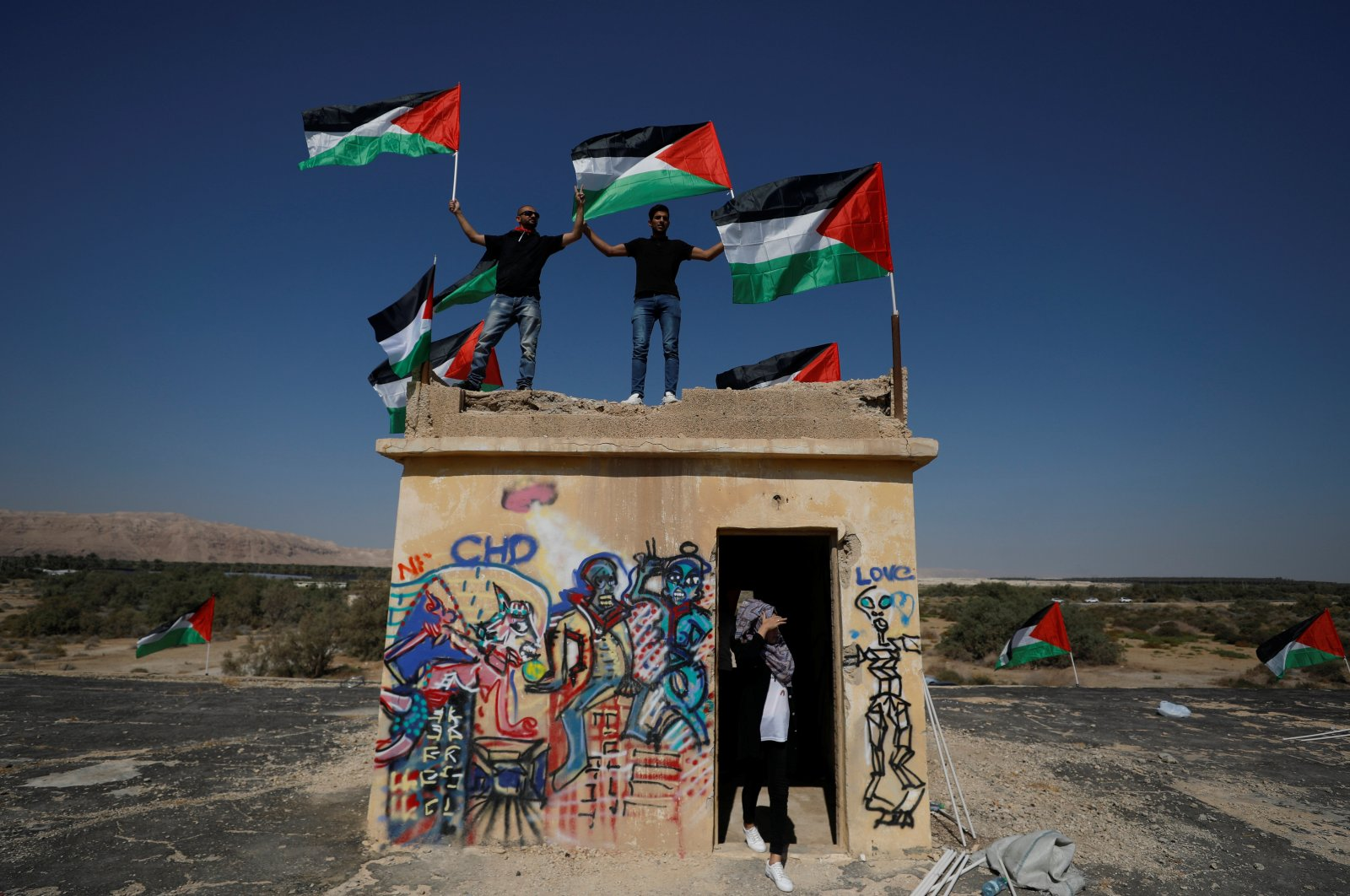Demonstrators hold Palestinian flags during a protest against Jewish settlements near the Dead Sea in the Israeli-occupied West Bank, Sept. 28, 2019. (Reuters Photo)