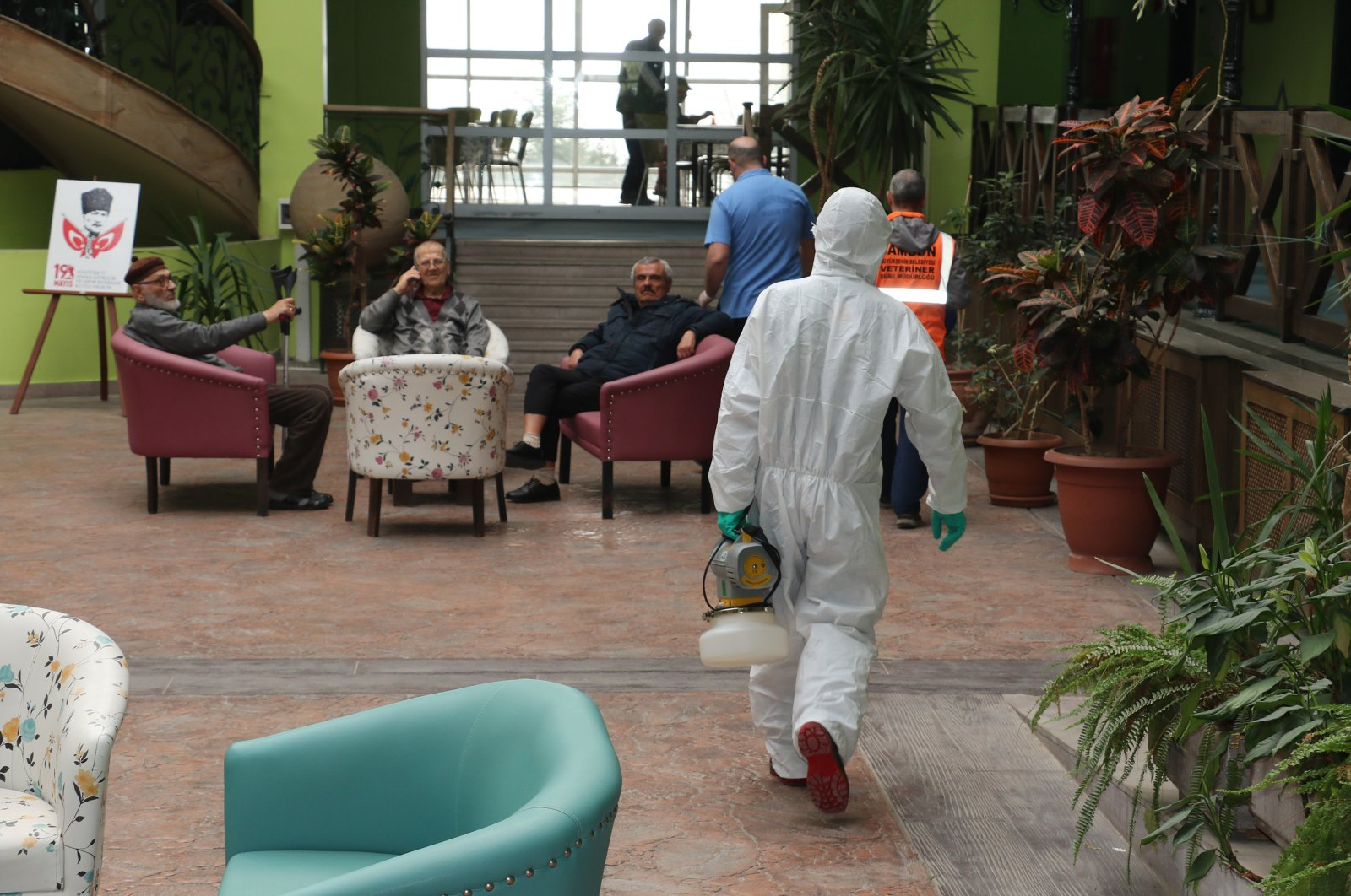 A health worker in protective suit walks around in a nursing home in Samsun, March 16, 2020. (DHA Photo)