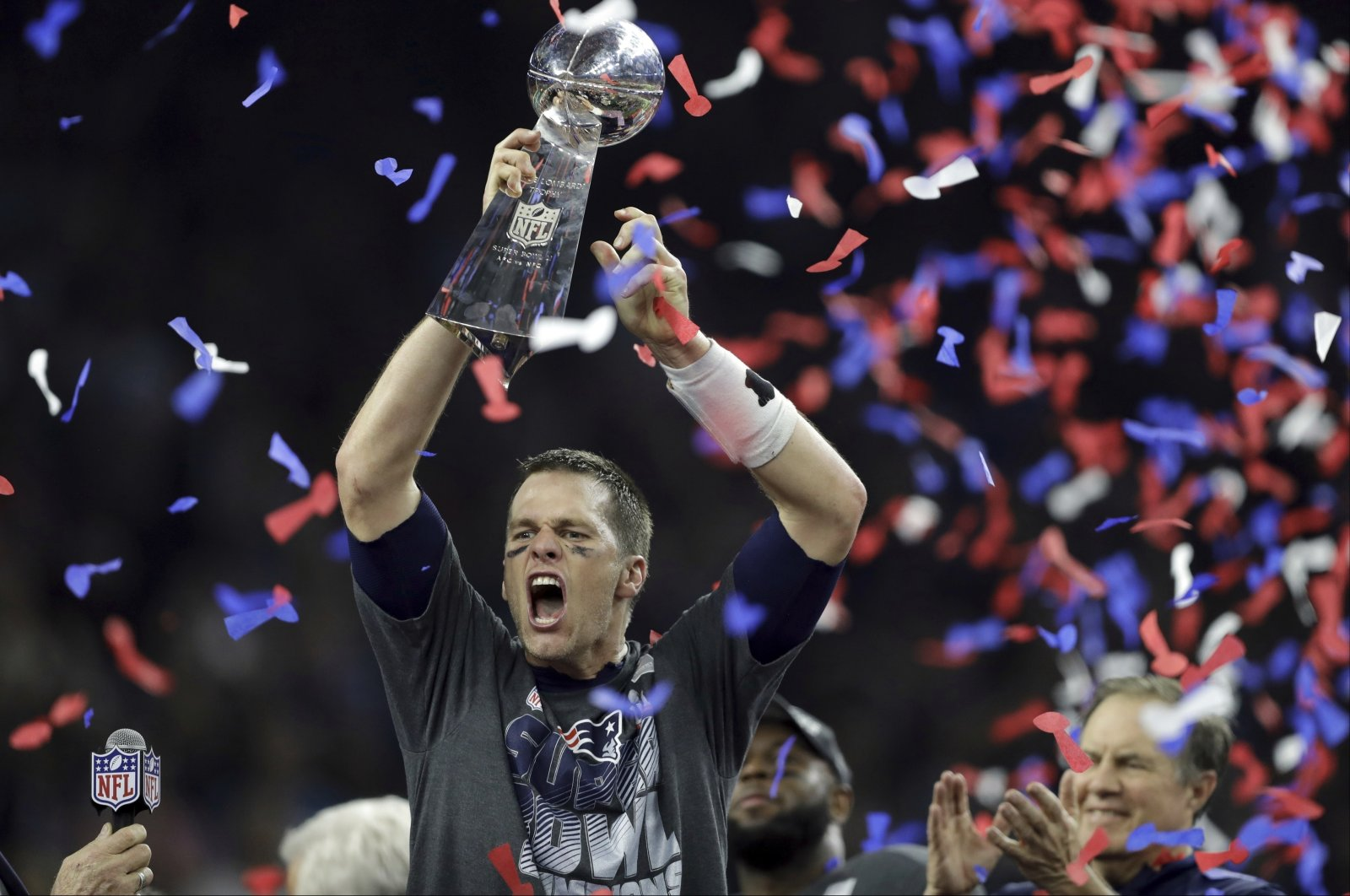 In this file photo, New England Patriots' Tom Brady raises the Vince Lombardi Trophy after defeating the Atlanta Falcons in overtime at the NFL Super Bowl 51 football game in Houston, Texas, Feb. 5, 2017. (AP Photo)