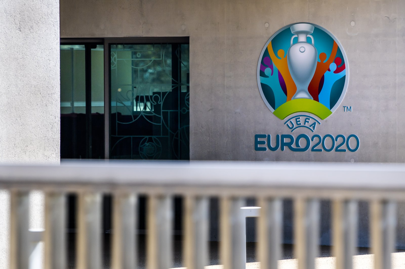 The Euro 2020 logo displayed next to the entrance of the UEFA Headquarters, in Nyon, Switzerland, Tuesday, March 17, 2020. (AP Photo)