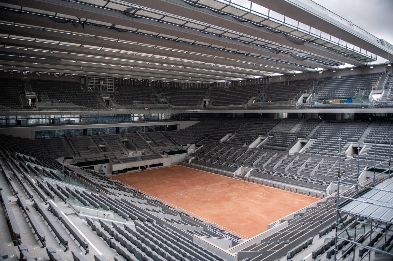 In this Feb. 5, 2020, file photo, construction work of the newly built roof of the Philippe Chatrier center court is pictured at Roland Garros stadium in Paris. (Pool via AP)