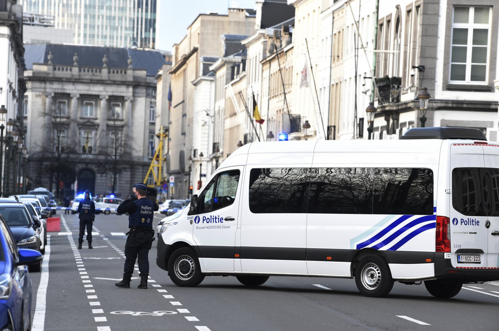 Belgian police has a street closed due to a suspicious car in front of 16 Rue de la Loi, the residence of Belgium's Prime Minister, during a National Security Council meeting at the premises in Brussels, Belgium, 17 March 2020. (EPA Photo)