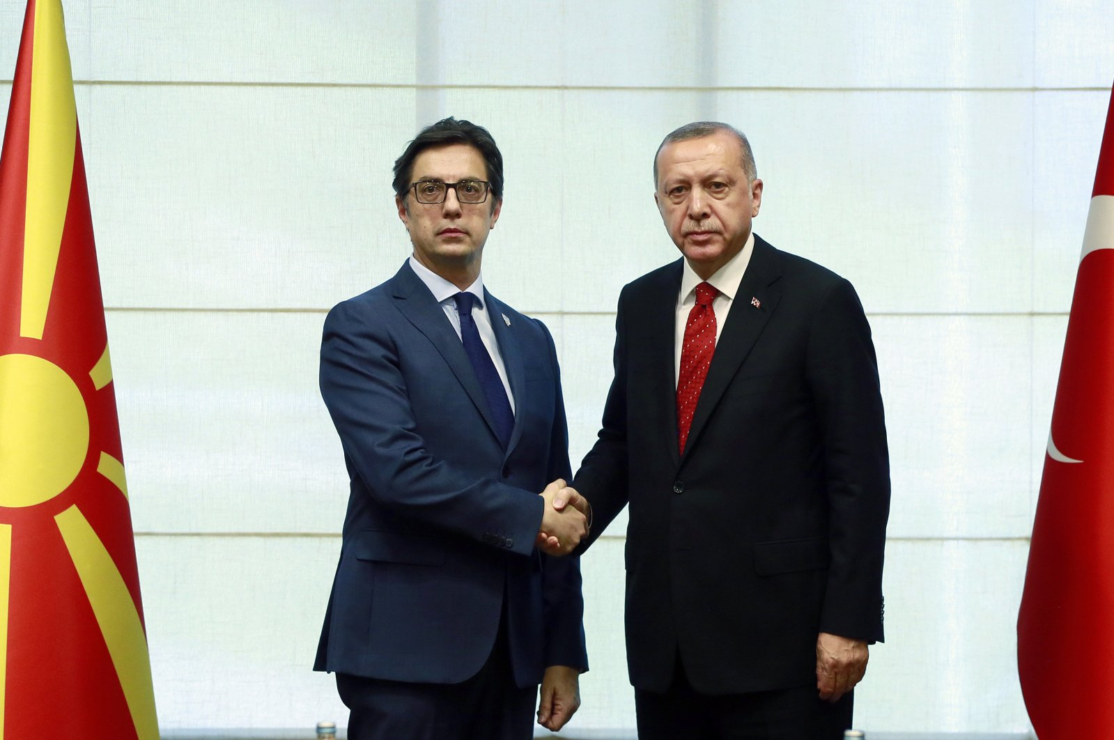 President Recep Tayyip Erdoğan, right, and President of North Macedonia Stevo Pandarovski shake hands during a meeting of the South-East European Cooperation Process at Mt. Jahorina, Bosnia, Tuesday, July 9, 2019. (AP Photo)