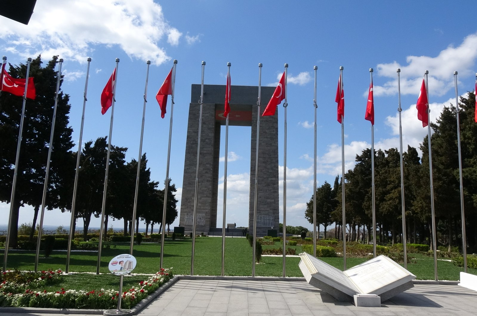 Martyrs' Memorial is seen behind Turkish flags, Wednesday, March 18, 2020, in Çanakkale. The memorial on Hisarlık hill, one of the battlefields during the campaign, is situated next to a cemetery for fallen soldiers. (İHA Photo)