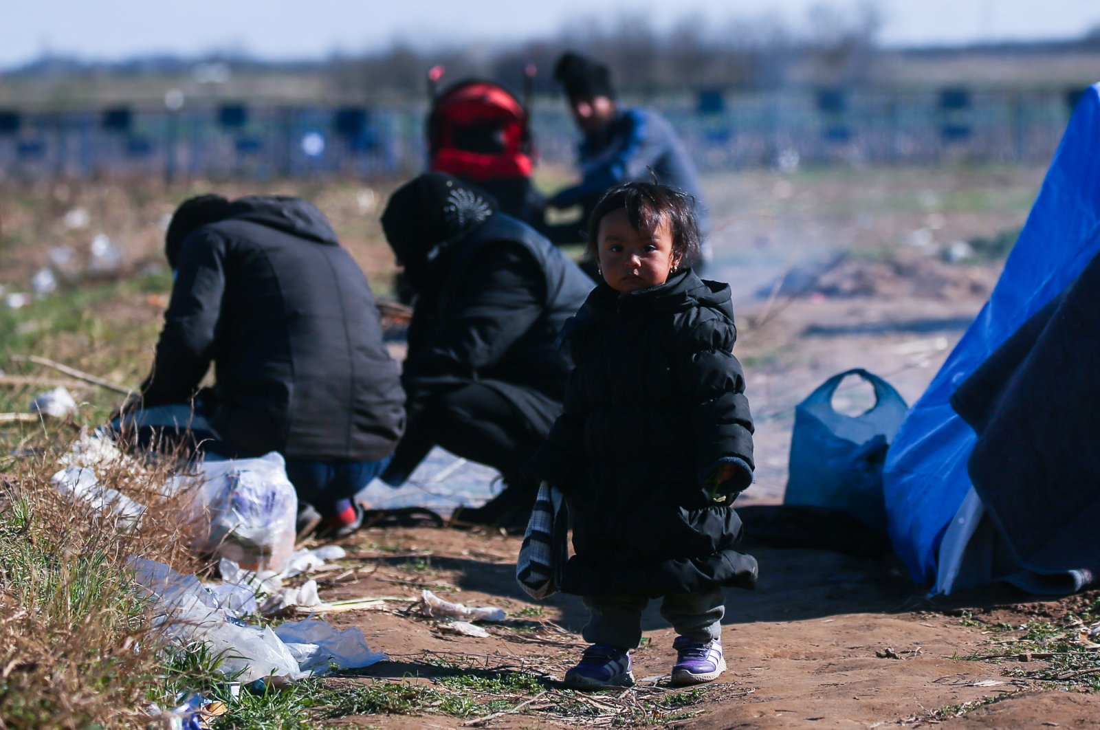A child is seen in the area near the Turkish-Greek border where asylum-seekers and migrants have been waiting for more than two weeks to enter Europe, March 16, 2020. (AA Photo)