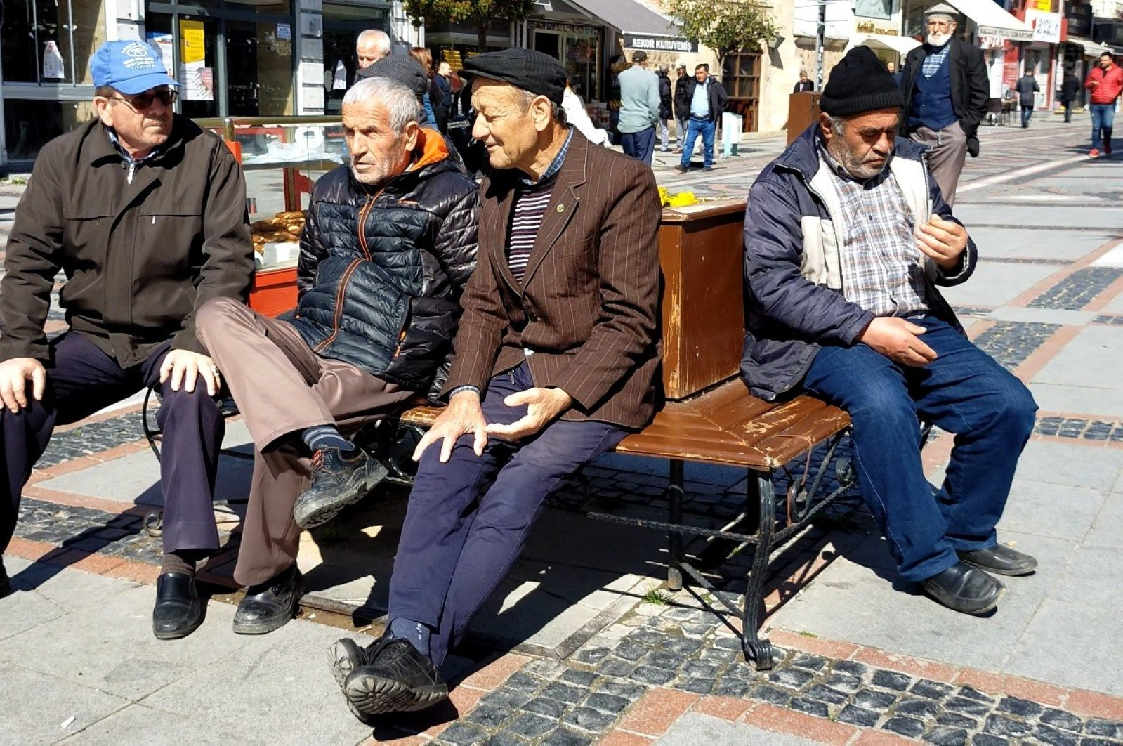 A group of elderly men sitting on a bench in Edirne, Turkey, Tuesday, March 17, 2020. (İHA Photo)