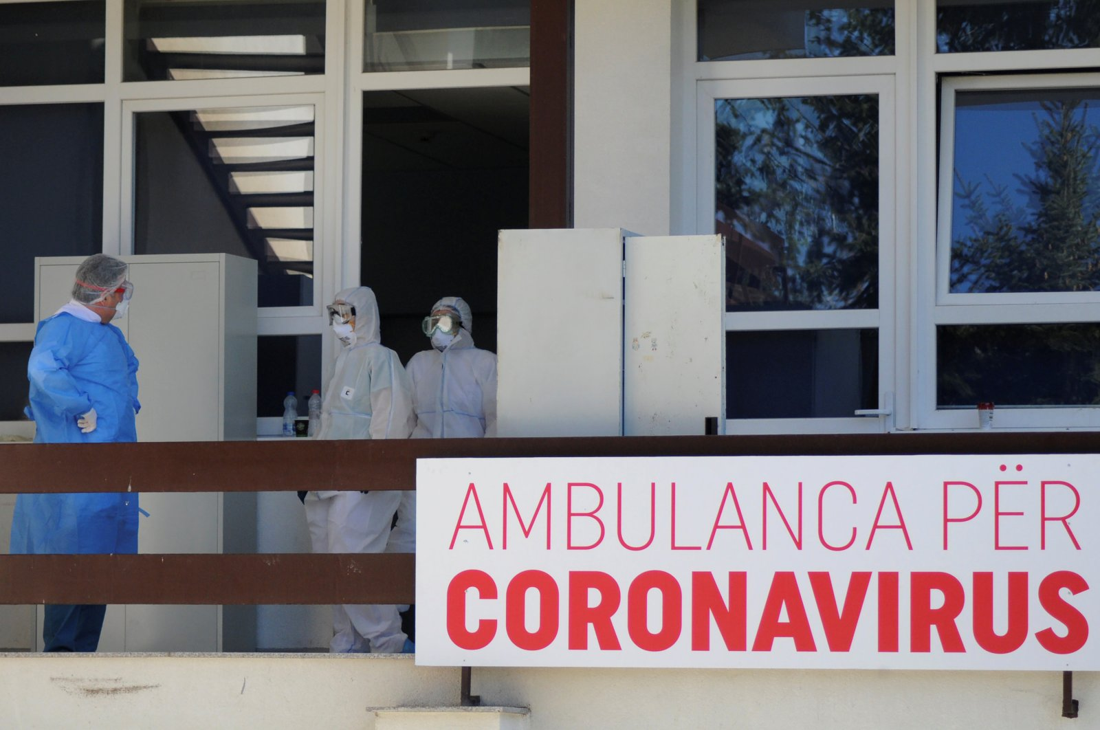 Medical workers stand in front of ambulance for coronavirus (COVID-19) patients, Pristina, March 16, 2020. (REUTERS Photo)