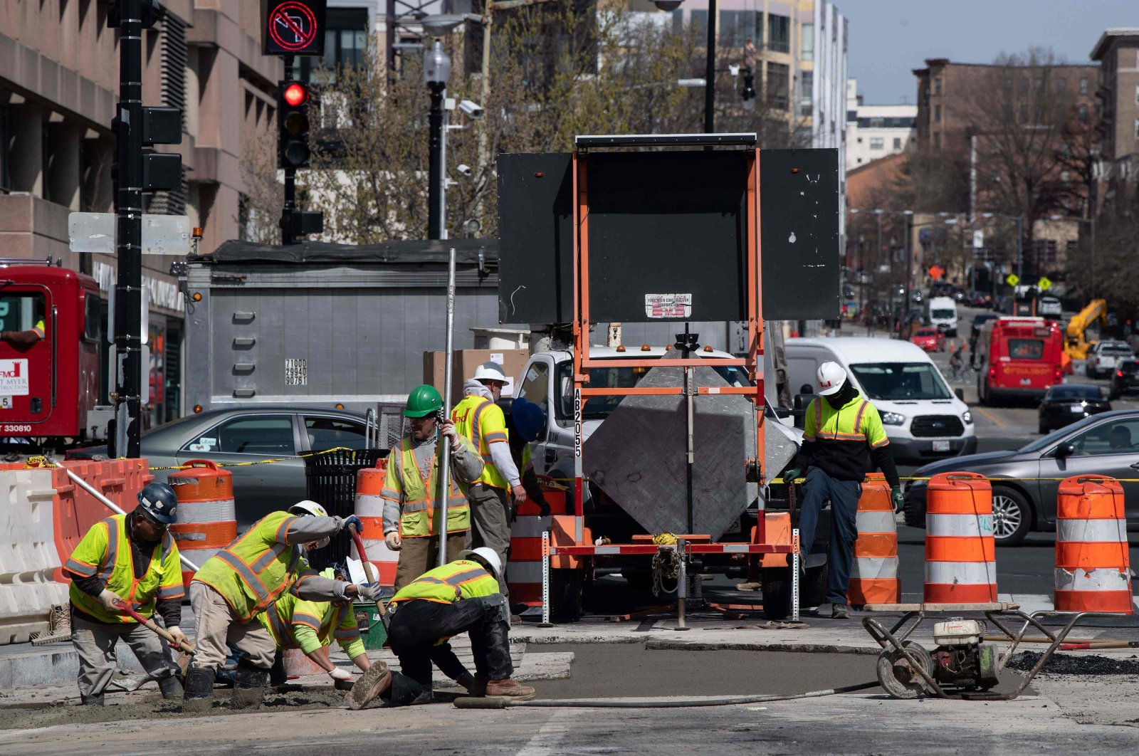 Workers repave a street in Washington, DC, on March 18, as the country deal with the novel coronavirus, COVID-19. (AFP Photo)