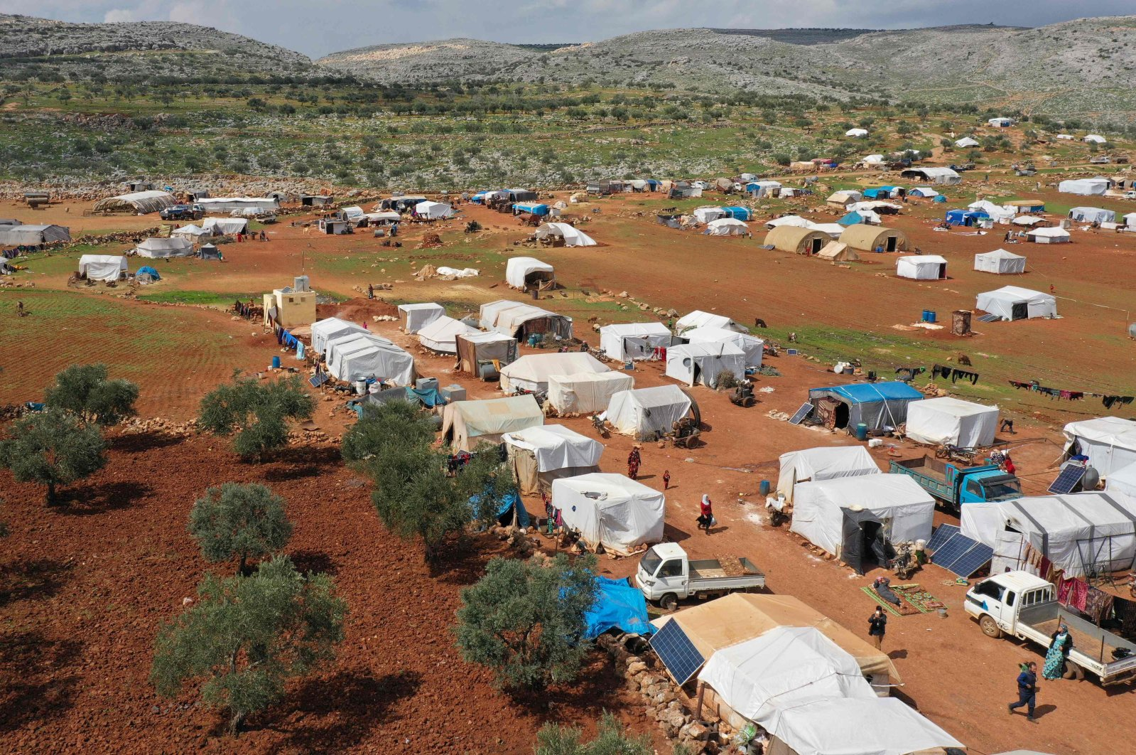 A drone image shows a displaced camp in the town of Kafr Uruq southwest of the town of Sarmada in Syria's northwestern Idlib province, Tuesday, March 17, 2020. (AFP Photo)