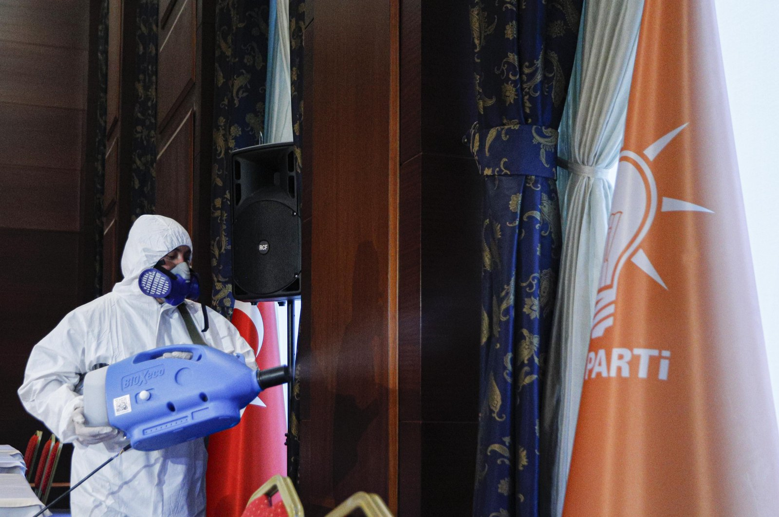 A worker disinfects AK Party headquarters in Ankara on Saturday, March 14, 2020. (DHA Photo)