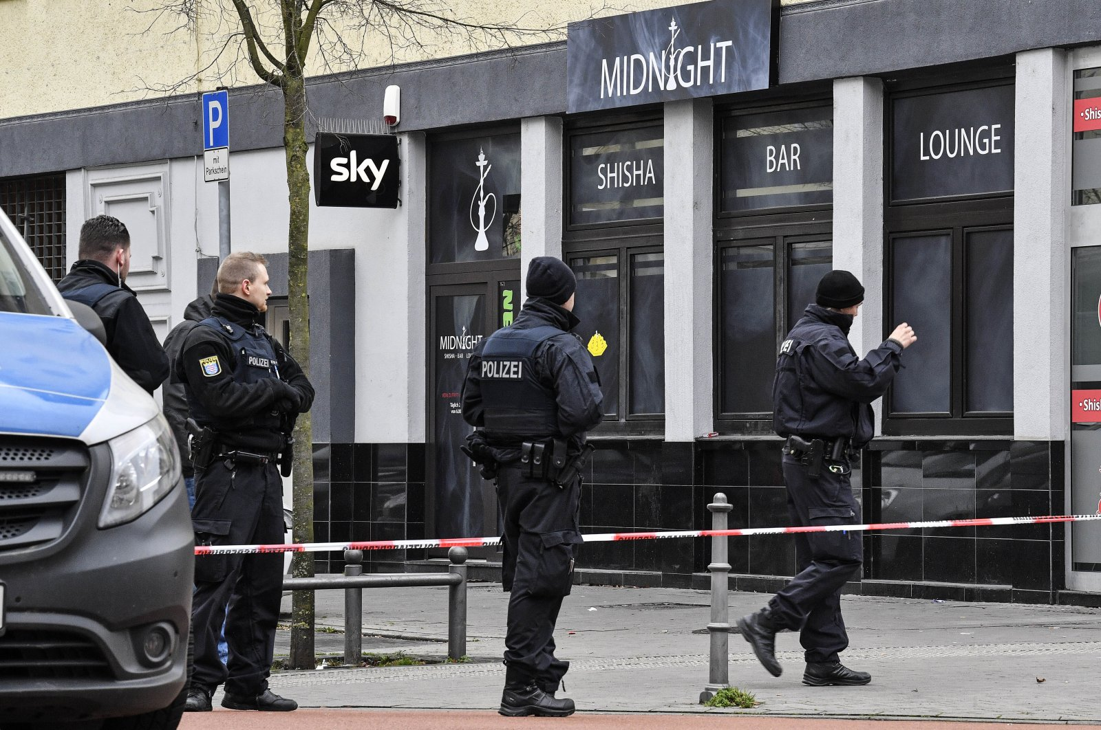 Police secure the hookah bar, Hanau, Feb. 20, 2020. (AP Photo)