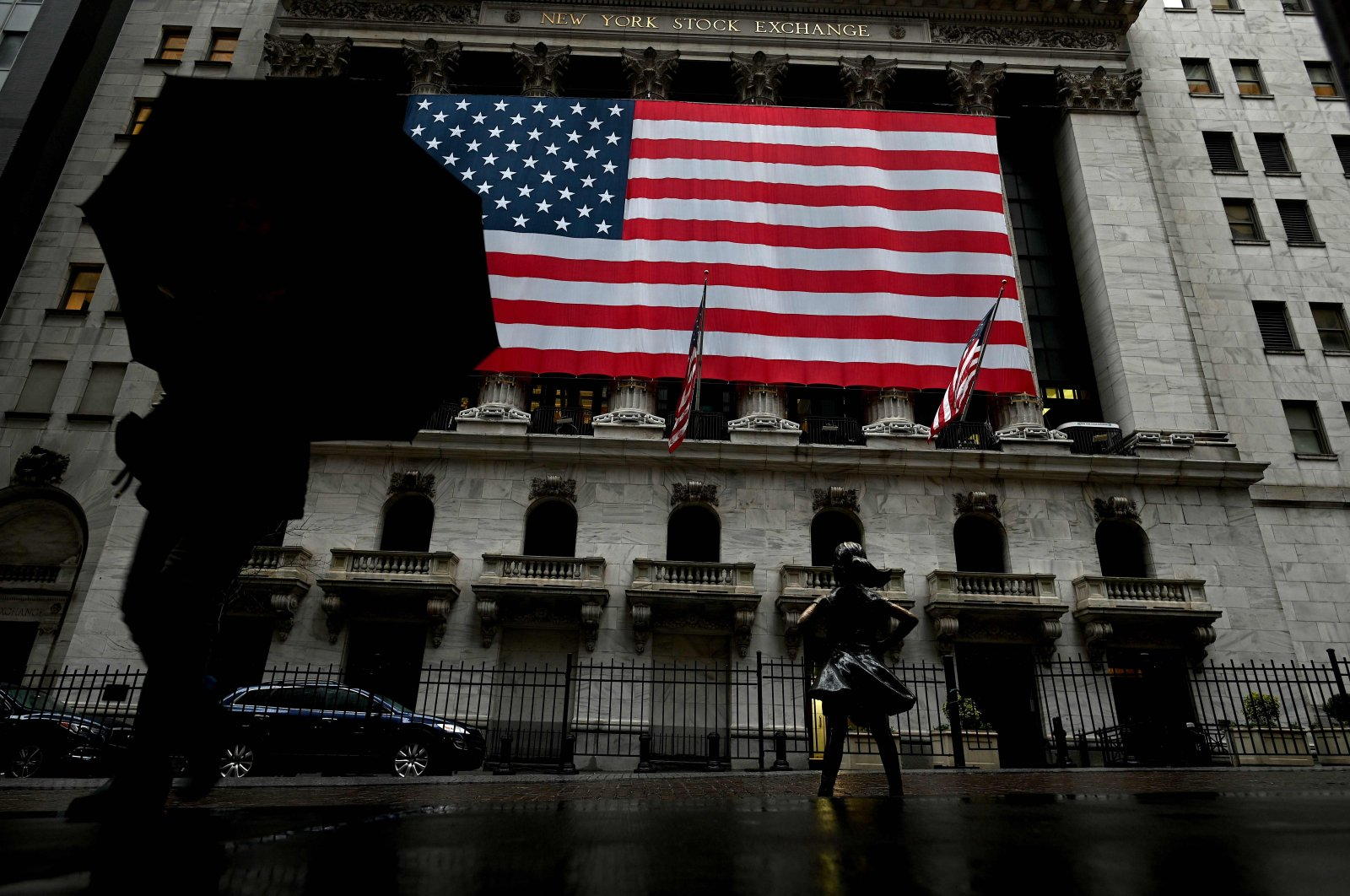 A woman walks past the New York Stock Exchange (NYSE) at Wall Street in New York City on March 19, 2020. (AFP Photo)