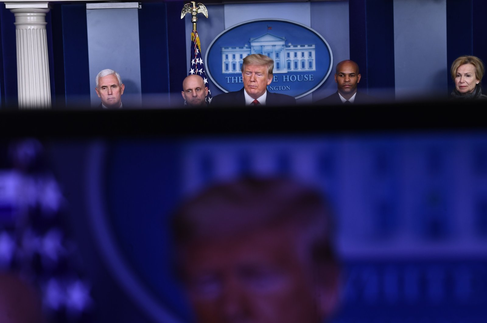 US President Donald Trump (C), with (L-R) Vice President Mike Pence, FDA Commissioner Stephen Hahn, US Surgeon General, Dr. Jerome Adams, and White House Coronavirus Task Force Coordinator, Dr. Deborah Birx, speaks during the daily briefing on the novel coronavirus, COVID-19, at the White House on March 19, 2020, in Washington, DC. (AFP Photo)
