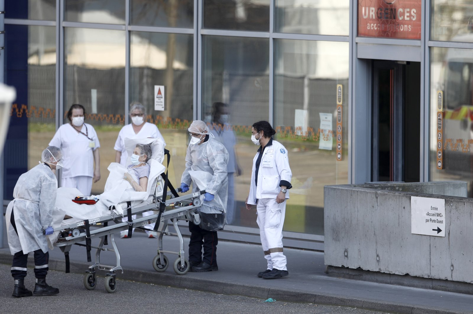 An elderly woman is admitted at the emergency service of an hospital in Strasbourg, eastern France, Thursday, March 19, 2020. (AP Photo)