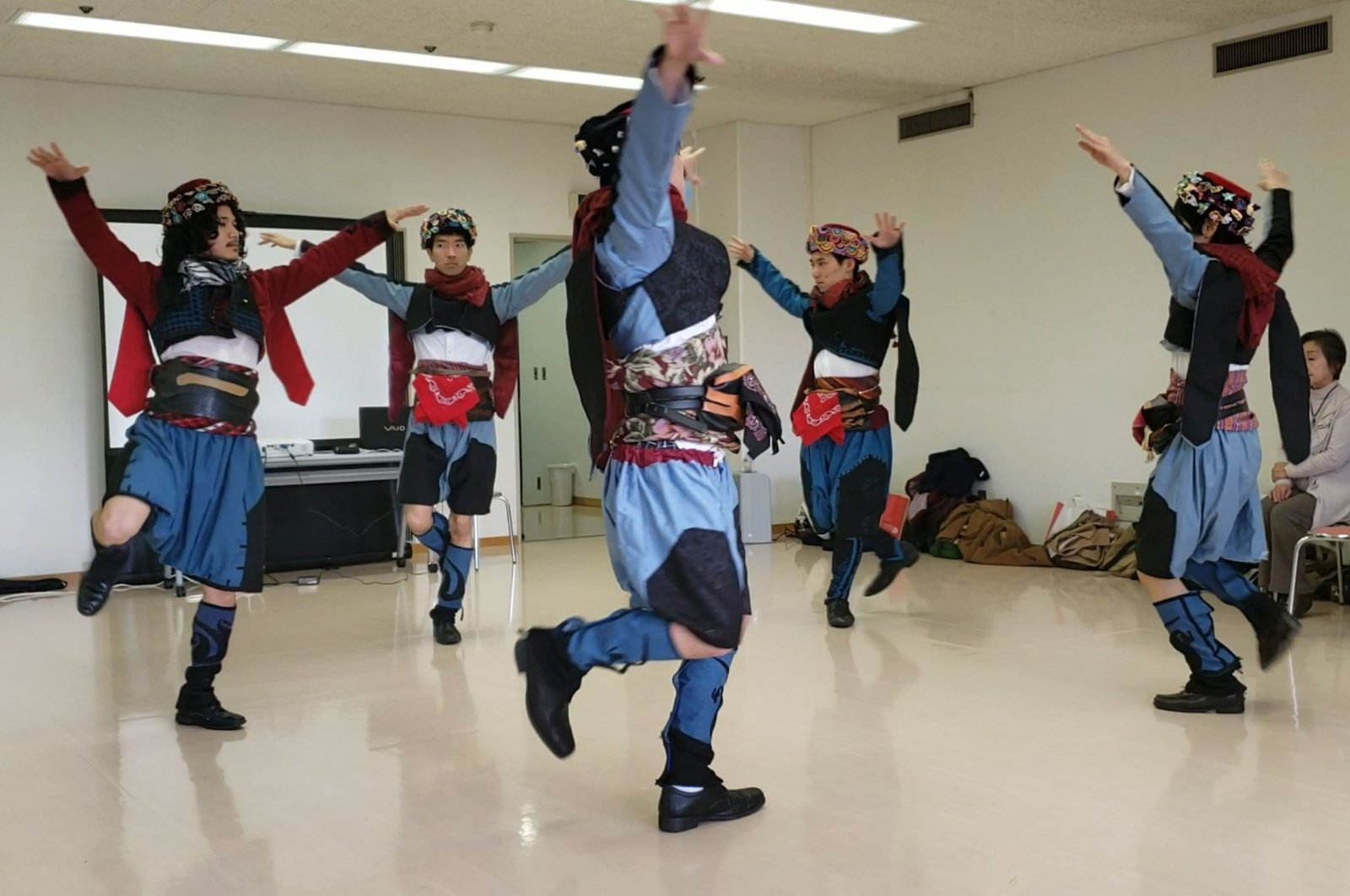 Still shot from the video of Takasaki Taito and his friends performing the Zeybek dance. (AA Photo)