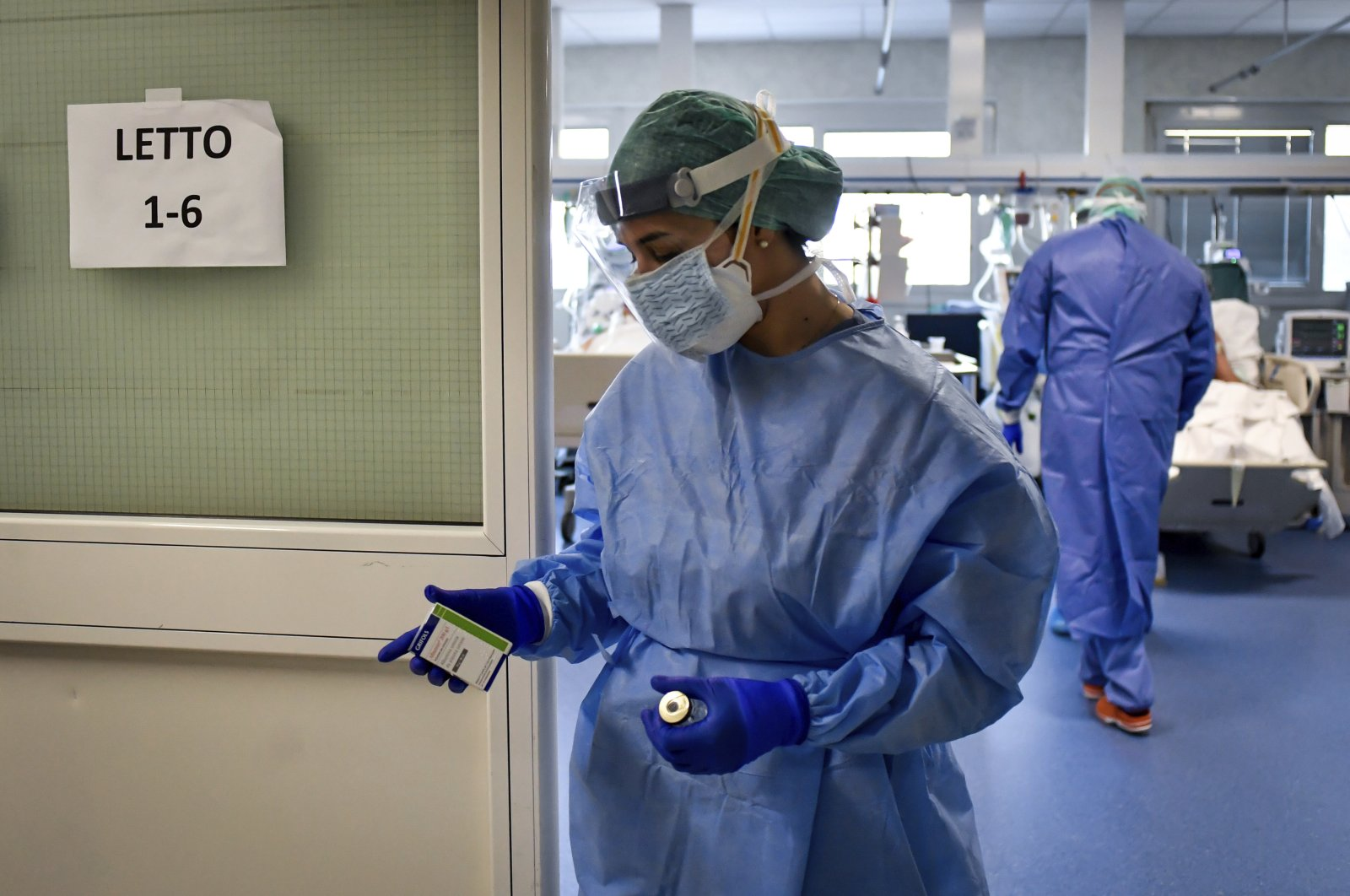 A nurse leaves the intensive care unit of the hospital of Brescia, Italy, Thursday, March 19, 2020. (LaPresse via AP)